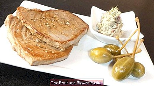 Tuna steak with spicy anchovy butter and caper berries