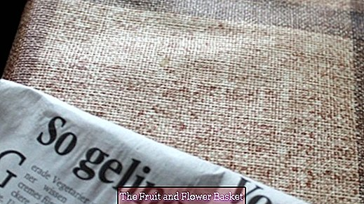 Remove printer ink from newspaper from oilcloth tablecloths