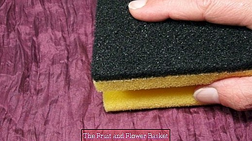 Remove lint with kitchen sponge