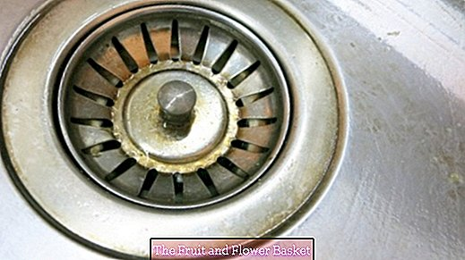Clean the drain strainer in the kitchen with oven spray