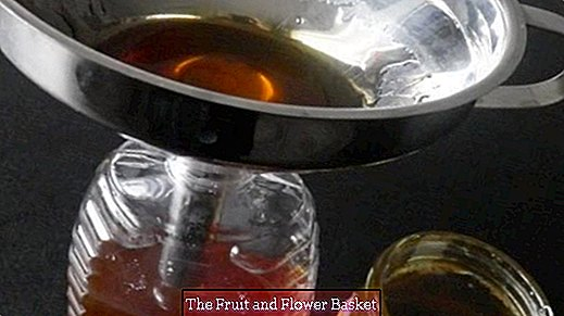 Transfer honey from the jar into existing empty liquor Bee