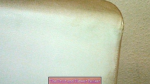 Remove stains from a bright leather couch - dirt eraser