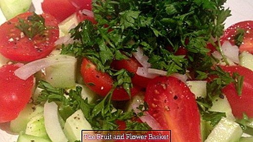 Fresh yummy cucumber tomato salad with parsley