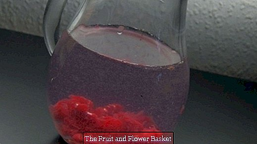 Flavored water: crushed raspberries in a jug of water